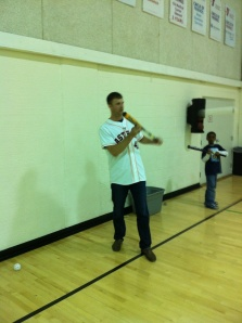 Jordan Lyles shows kids how to bunt. Something he won't really have to do anymore with the Astros move to the AL.