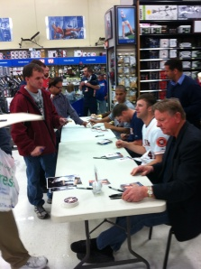 Members of the CAREavan do a meet and greet at Academy Sports + Outdoors